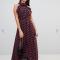 Marineblauwe jurk met roestkleurige print en haltertop