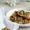 Champignonwieltjes met peterselie en kaas