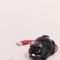 Zwarte kabelclip in de vorm van een kat