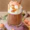 Chocolademelk met pompoen en slagroom