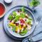 Voorgerecht: sinaasappelsalade met granaatappel en amandelen