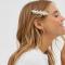 Goudkleurige haarclip met opschrift 'Glam' bezet met parels
