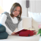 Un coussin pour lire confortablement au lit