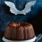 Chocoladekerstcake met kweepeerglazuur