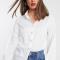 Wit hemd met parelknopen