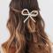 Goudkleurige haarspeld met strik
