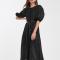 Zwart midi-jurk in organza met stippenmotief en riempje
