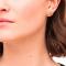 Vergulde studs in de vorm van lippen