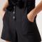Zwarte short met fluwelen strik