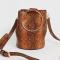 Bucket bag in imitatieleer met slangenprint en goudkleurige ringen