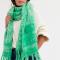 Groene sjaal met franjes