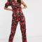 Zwarte asymmetrische jumpsuit met bloemenprint