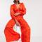 Oranje jumpsuit in jacquard met pofmouwen