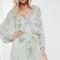 Muntgroene mini-jurk bezet met parels en pailletten
