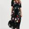 Zwarte maxi-jurk met geborduurde bloemen