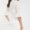 Crèmekleurige mini-jurk met korte mouwen in broderie anglaise