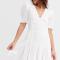 Linnen mini-jurk met knopen en korte mouwen in ivoor