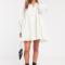 Ivoorkleurige mini-jurk met lange mouwen in jacquard