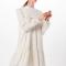 Korte jurk met stippenmotief en opstaand kraagje