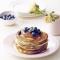 Pannenkoeken met blauwe bessen en esdoornsiroop