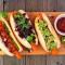 Veganistische hotdogs van wortel