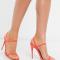 Oranje sandalen met naaldhakken