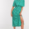 Groene midi-jurk met korte mouwen en witte bloemenprint