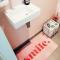 Roze badmat met opschrift 'Smile'