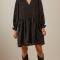 Zwarte mini-jurk met ballonmouwen