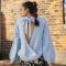 Pastelblauwe trui met strikdetail