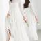 Robe de mariée à paillettes et manches longues