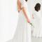 Maxi-jurk bezet met parels en kraaltjes en vlindermouwen