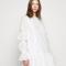 Mini-jurk met rugdecolleté en borduursels