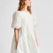 Mini-jurk in jacquard met pofmouwen