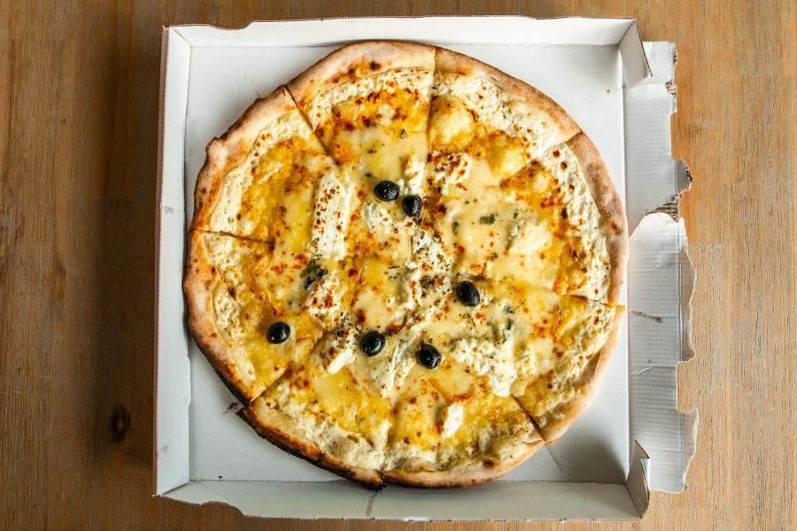 Pizza 257 fromages à Lyon - Photo Prétexte Getty Images