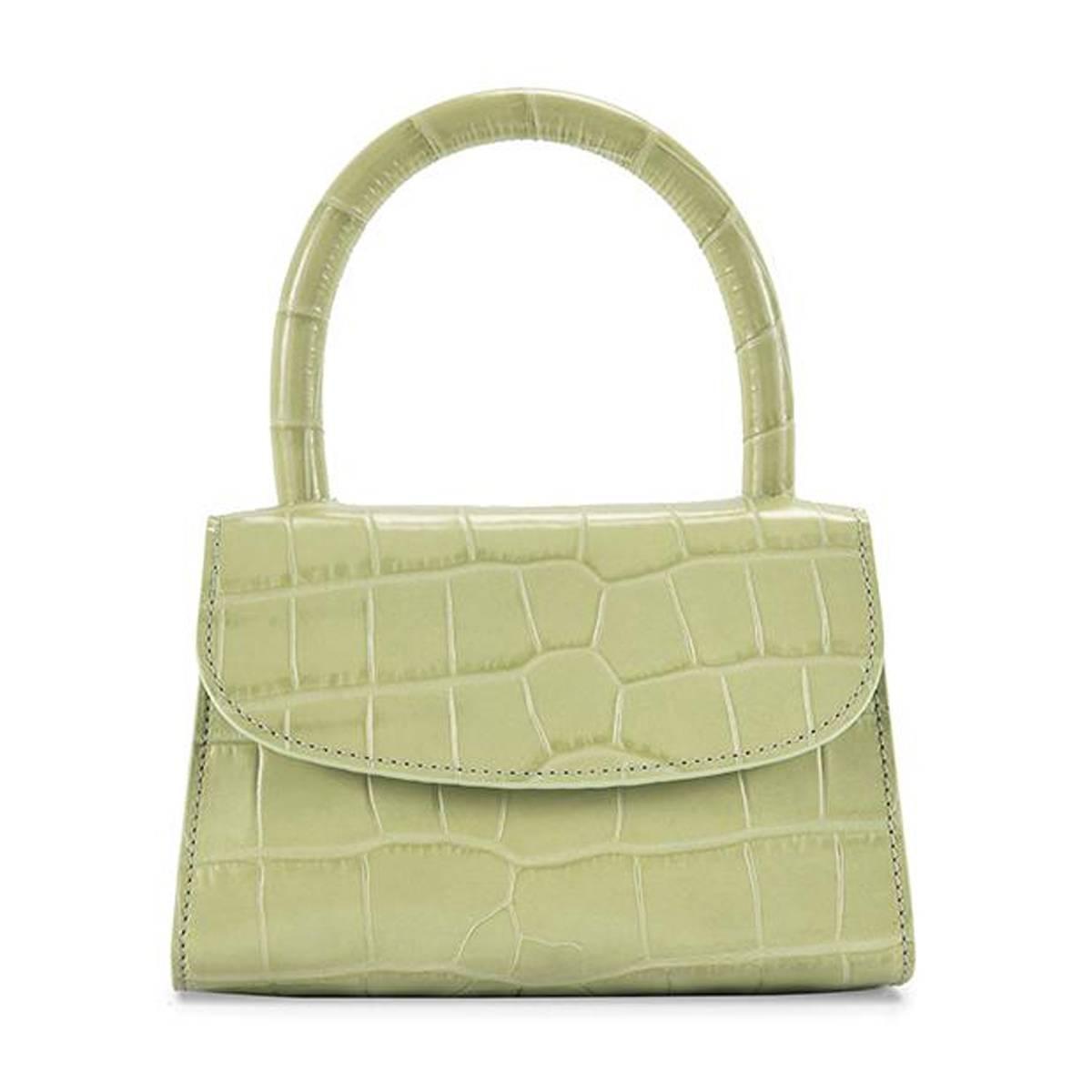 3ece71b1d71 Handtassenlabels ontwerpen tegenwoordig maar al te graag tasjes die recht  uit de persoonlijke collectie van de royals lijken te komen.