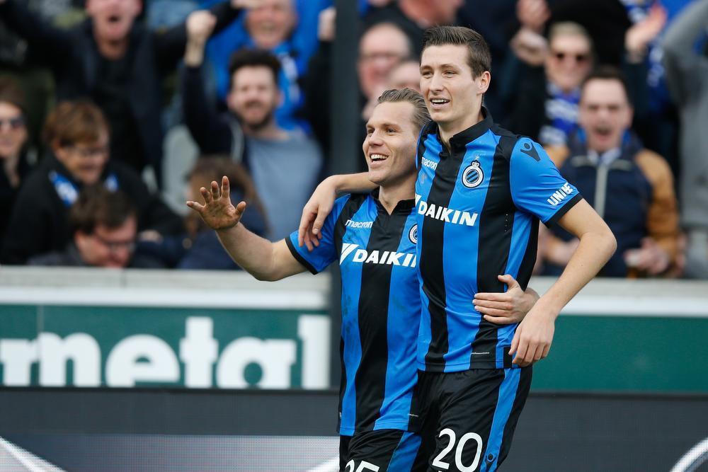 Ruud Vormer en Hans Vanaken vieren een doelpunt.