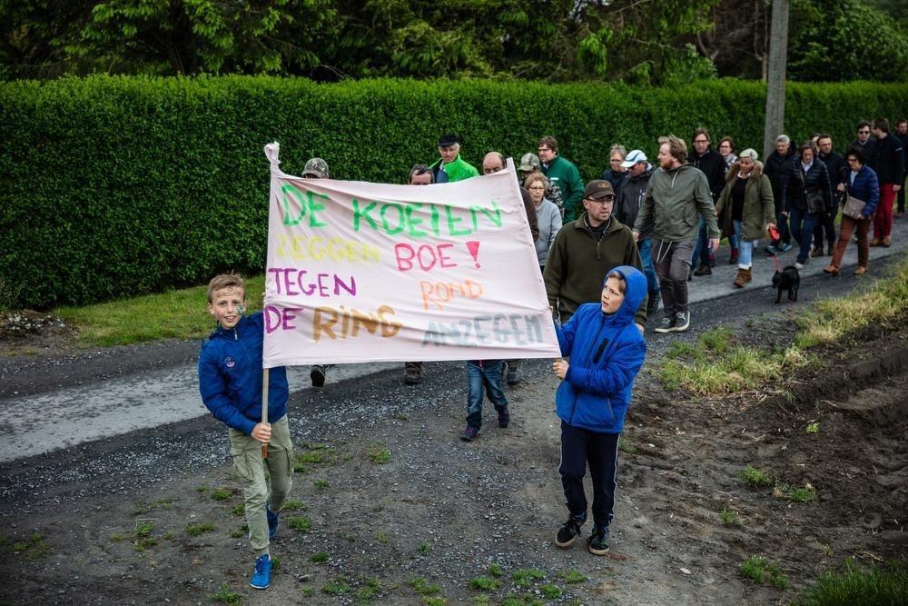 De actievoerders hielden verschillende spandoeken op om hun grieven duidelijk te maken.