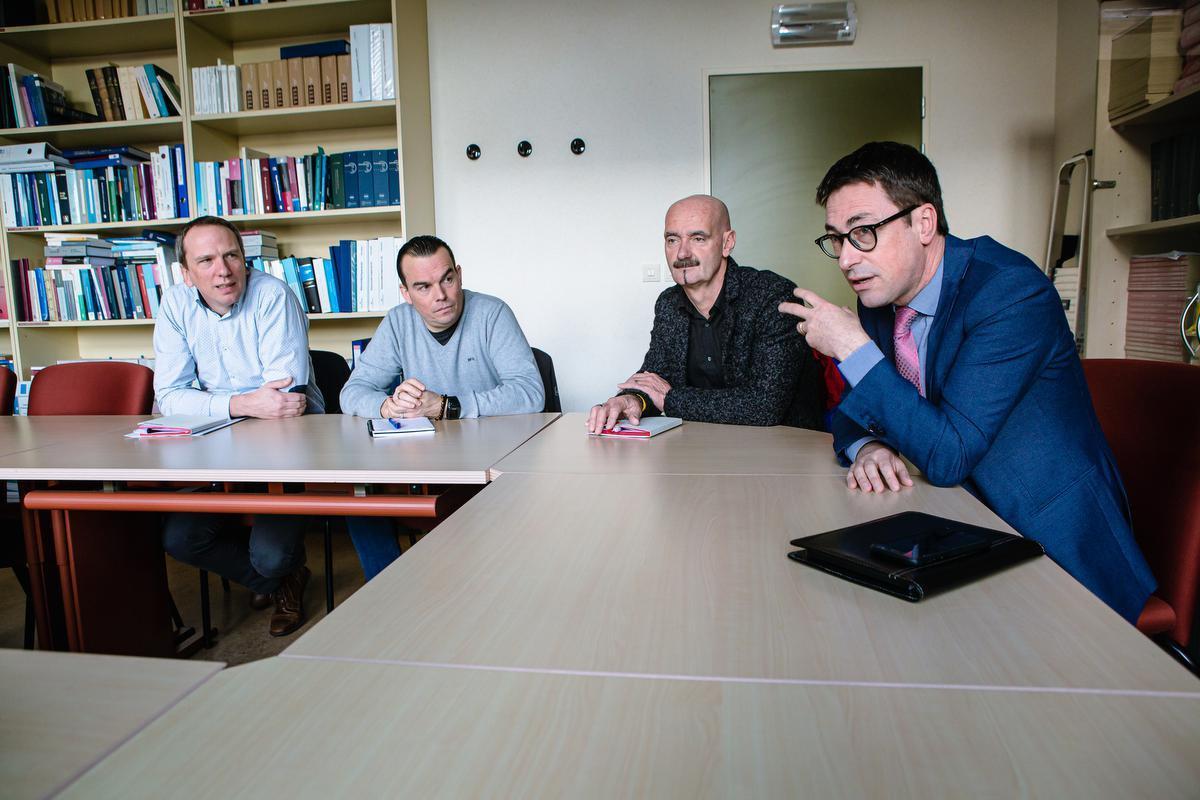 Cedric Van Eenoo, Sven Brunclair, Luc Vanmassenhove en Frank Demeester. De foto werd genomen voor de coronamaatregelen.