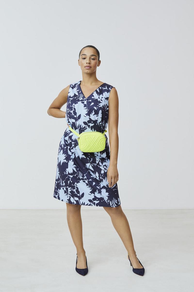Ook een accessoire in (fluo)geel geeft je outfit een boost (Foto Xandres Gold)