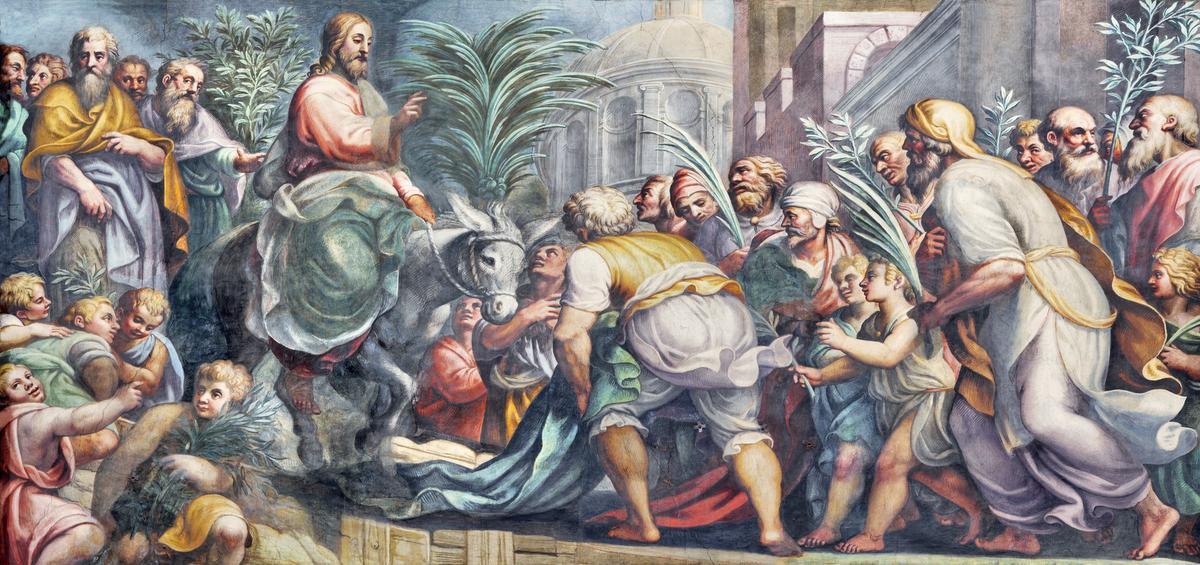Op Palmzondag herdenkt de Kerk de intocht van Jezus in Jeruzalem. Deze fresco van Lattanzio Gambara uit de zestiende eeuw beeldt dat tafereel uit.