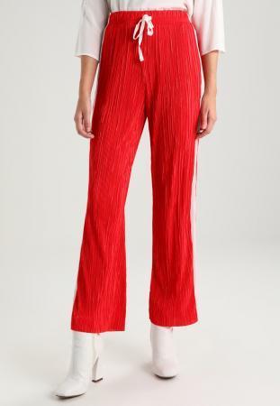 Pantalon rouge à bandes contrastantes blanches