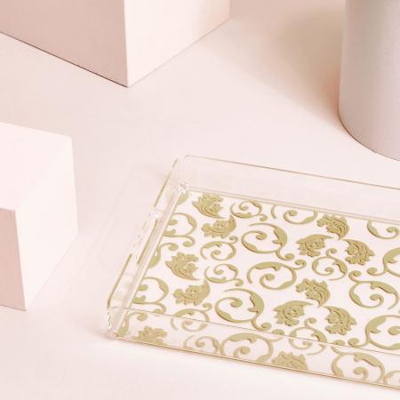 Plateau transparent à motif doré
