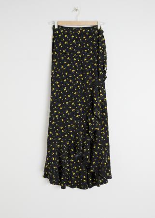 Jupe portefeuille noire à fleurs jaunes