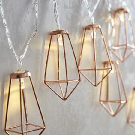 Lichtgevende slinger met koperen diamanten