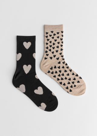 Set van twee paar zwarte en beige sokken met hartjesmotief