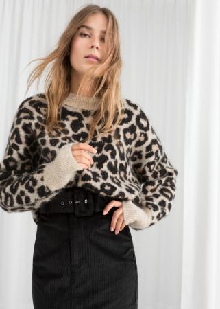 Beige trui met luipaardmotief