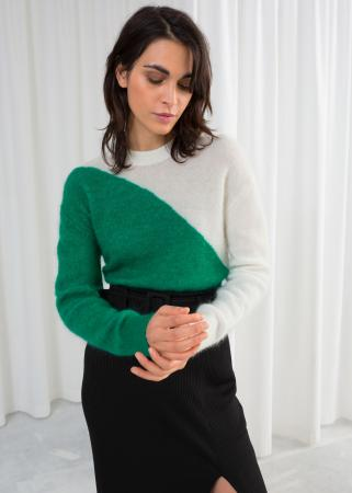Witte wollen trui met groene tekening