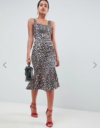 1. Een jurk met luipaardprint