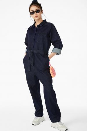 Donkere jumpsuit met riem